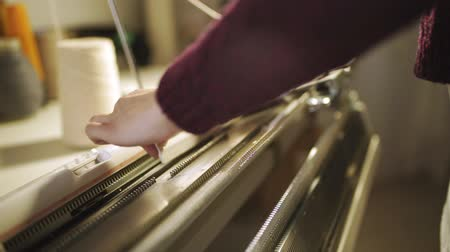 ladění : Female hands working on weaving machine at textile factory. Close up woman tunning loom machine for making knitted fabric. Tunning automated knitting machine in workshop
