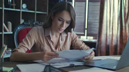 errado : Female manager have stress at work. Tired business woman working on notebook with financial data. Business mistake concept. Stressed woman take hands on head. Upset woman solving business problem Stock Footage