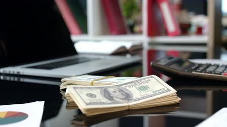parceiro : Bundles of money dollars at business deal. Close up of money deal at office table. Cash credit in dollar currency. Money deal at business meeting. Partner give cash dollars for contractor