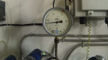 electromotor : Device for measuring pressure in big pipes of heating supply for residential complex Stock Footage