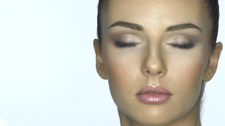 arc : Beautiful young woman face close-up. Healthcare and skin treatment concept.