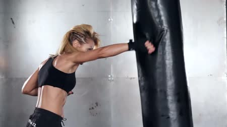 bokszoló : A beautiful and fit woman has a kickboxing training. Sport, health, concept.