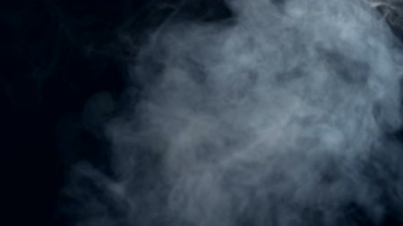 fuvalom : Smoke on a black background in slow motion.