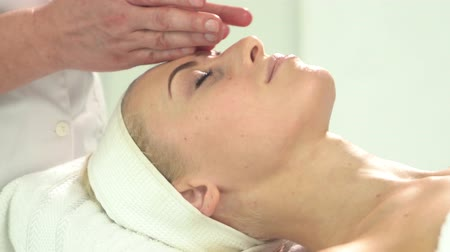 healer : Young attractive woman getting spa treatment over white background Stock Footage