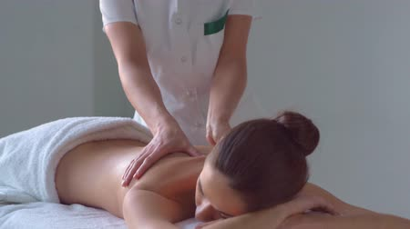 healer : Young woman in spa. Traditional healing therapy and massaging treatments. Health, skin care, massage, osteopathy and recreation.