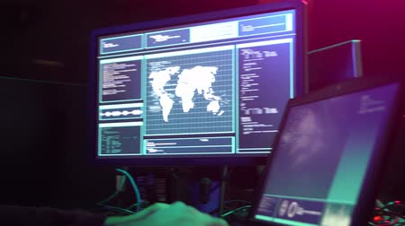 darknet : Internet fraud, darknet, data thief, cybercrime concept. Hacker attack on government server. Criminals coding virus programs. Stock Footage