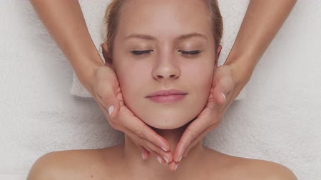 healer : Young, beautiful and healthy woman in spa salon. Traditional Thai massage therapy and skin care. Stock Footage
