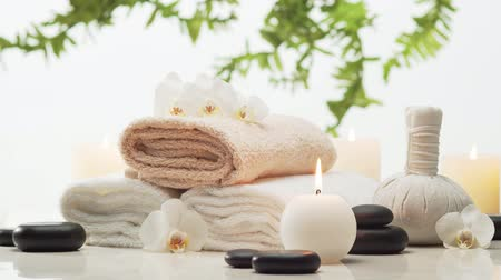 лечение : Spa background. Towel, candles, flowers, stones and herbal balls. Massage, oriental therapy, wellbeing and meditation.