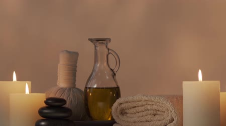 flowers oil : Oriental massage treatment composition. Spa procedures, meditation, wellbeing and aromatherapy. Stock Footage