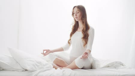Happy pregnant woman meditating. Pregnancy, motherhood, and expectation concept