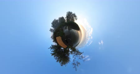 kiev : 4k little planet. Landscape timelapse of beautiful sunrise sky over lake Stock Footage