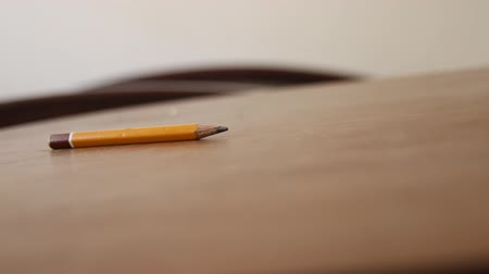ołówek : Pencil lying on a wooden table, education background.