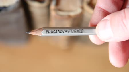 przyszłość : Education Future words on gray pencil and books