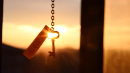 success : Key and text success against sunset rays Light. Golden key to success concept. Stock Footage