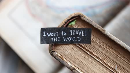 kaland : i want to travel the world inscription on the label, old books and maps