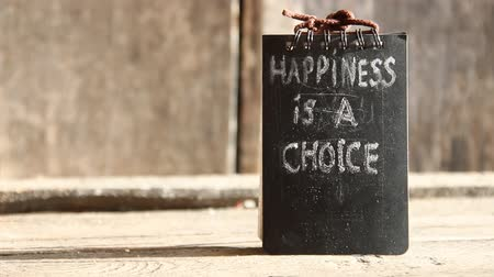 vida : Words happiness is a choice.  Inscription on the black plate.