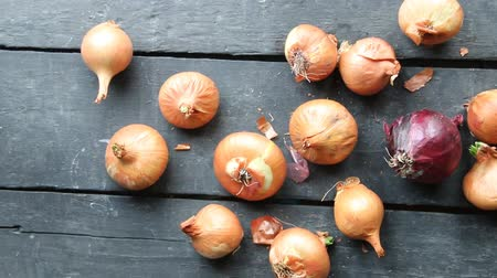 wood : onions on rustic wood Stock Footage
