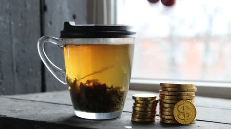wykresy : graph of gold coins and a mug of tea, profit, income concept