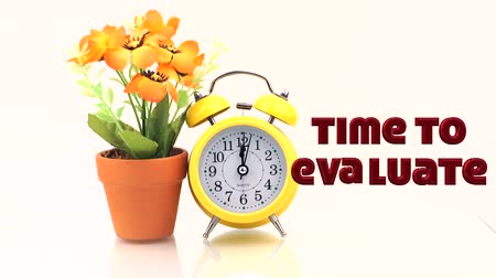 assess : concept alarm clock on isolated white background with simple animation word TIME TO EVALUATE