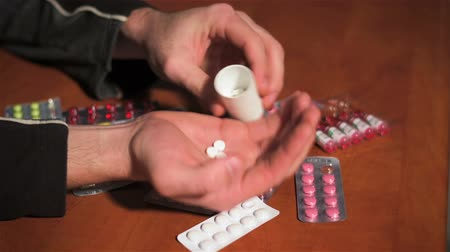 viciado : Person frantically pours pills from container. People take pills. Pills and drugs close up Vídeos
