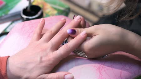 manicure : Treatment of nail with brush in nail salon. Close up. Actual process of performing manicure. Woman in nail salon Stock Footage