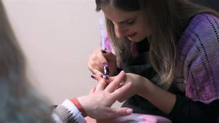 mimos : Cosmetic procedure for treatment of nails on fingers. Actual process of performing manicure. Woman in nail salon
