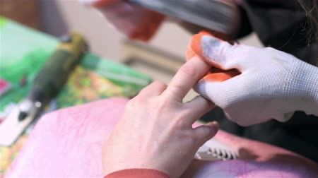 mimos : Nail care, polishing, giving them form. Actual process of performing manicure. Woman in nail salon Stock Footage
