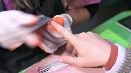 dosya : Shaping ofnails. Actual process of performing manicure. Woman in nail salon