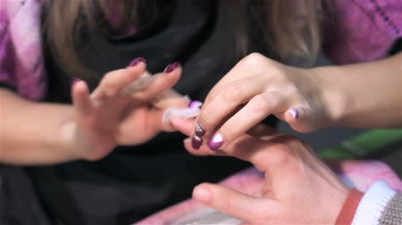 manicure : To nail plate with moisturizing foundation. Actual process of performing manicure. Woman in nail salon