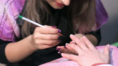 mimos : Staining nails in black color. Actual process of performing manicure. Woman in nail salon Stock Footage