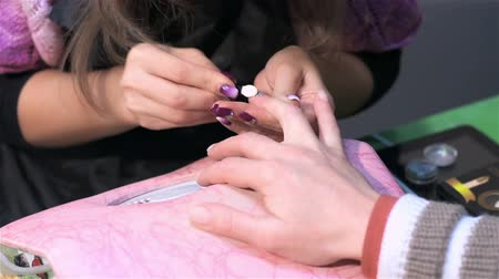 mimos : Nail extensions using acrylic. Actual process of performing manicure. Woman in nail salon