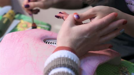 manicure : Professional master of manicure in salon. Close up. Actual process of performing manicure. Woman in nail salon Stock Footage
