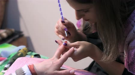 manicure : Professional master of manicure in salon. Actual process of performing manicure. Woman in nail salon