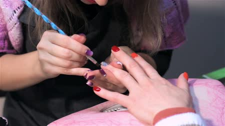 manicure : Nail care in nail saloon. Actual process of performing manicure. Woman in nail salon