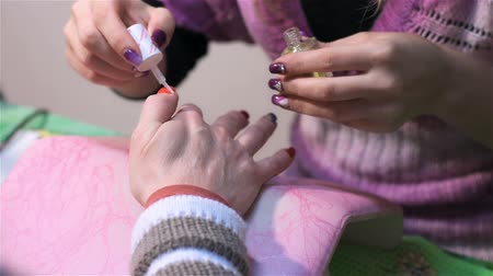 mimos : Disinfection of nails during manicure. Actual process of performing manicure. Woman in nail salon Stock Footage