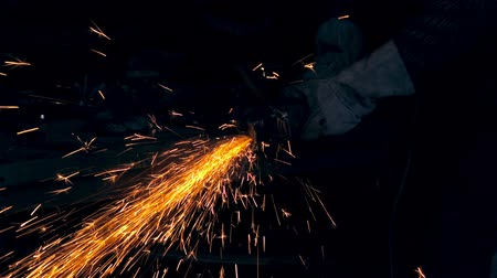 pour out : Sparks fly off metal. Man working at the forge. Worker heavy metallurgy
