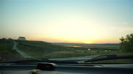 руки : View from car descending from mountain to river. Car is moving along country road