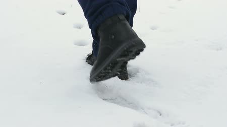 Hunter boots is on trail of wounded animal in snow