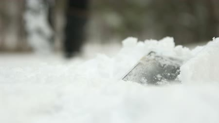 Phone falls in snowdrift and man does not notice that lost it and walk away