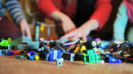 maravilhoso : Family of three people chooses details of construction toys to create robot Stock Footage