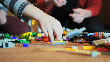 maravilha : Close up of family hand with children playing in room with construction toys