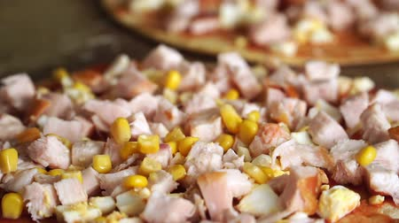 crust : Slow motion of canned corn grains fall on pizza