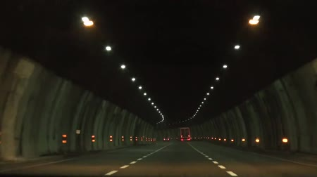 manmade : Car drives though tunnel