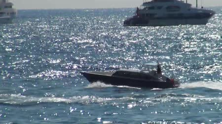 manmade : Close view of boat floating fast on the surface of the sea