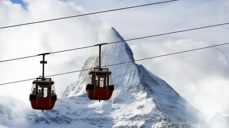 snows : Ski lift on mountains background. Stock Footage