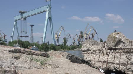 dry zone : Stones on background of stones shipbuilding cranes river