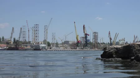 dry zone : Stones on background of shipbuilding cranes river