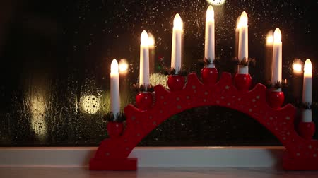 İsveççe : Traditional swedish window decoration for Christmas holiday. Stok Video
