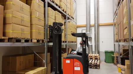 forklift : A working man moving cartons in warehouse warehouse. Industrial. Transportation concept. 01.09.2019. Enkoping Sweden.