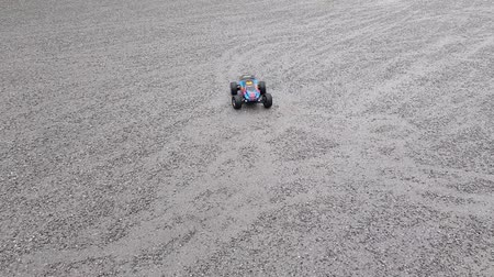 atv : Beautiful close uphort film showing a toy car spinning on asphalt. Beautiful backgrounds.